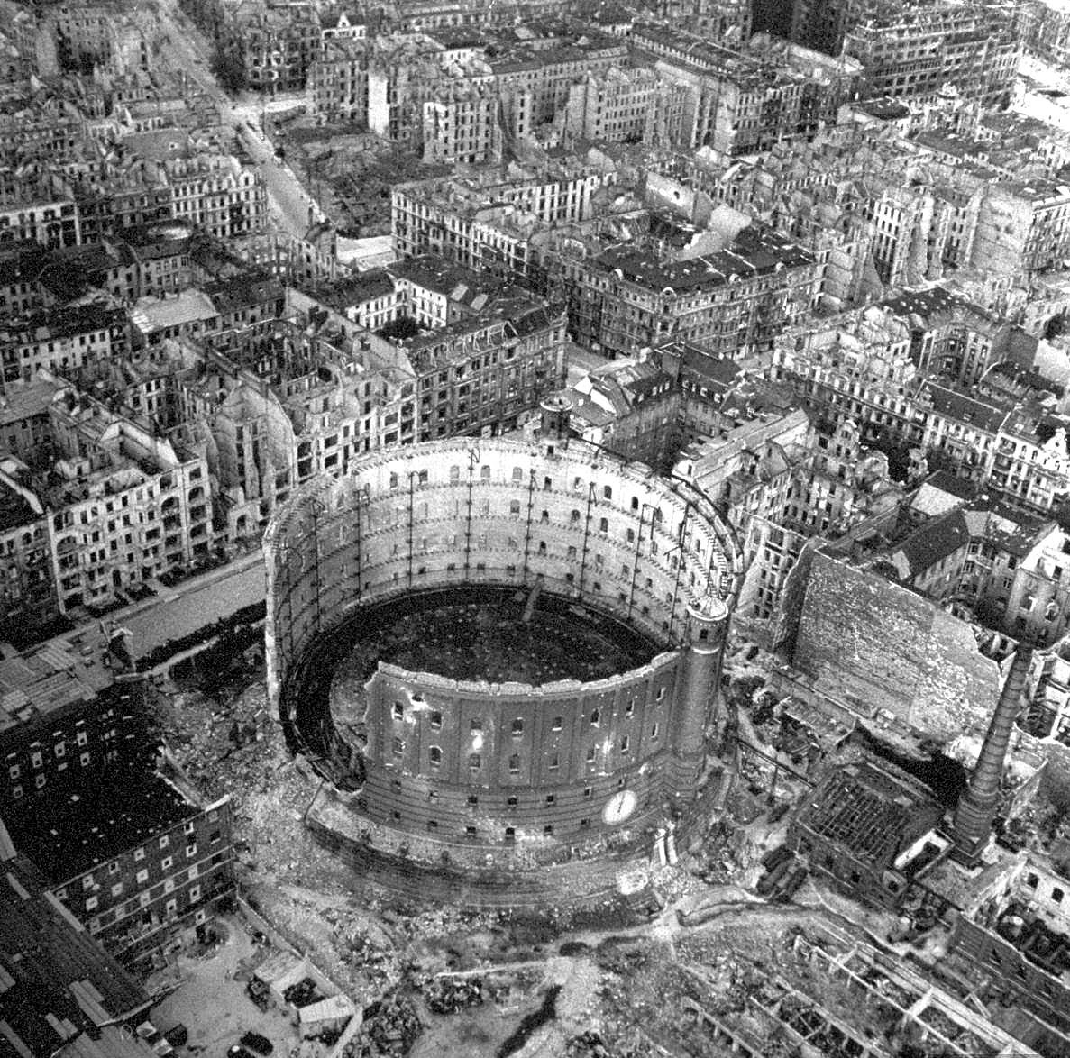 Excellent aerial view showing devastation and bombed out buildings over wide area.