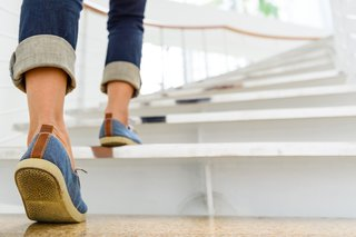 Image of a person walking up a flight of stairs