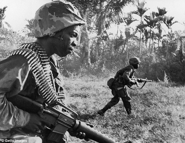 In the Vietnam war (pictured) U.S. troops reportedly threw away their M-16s and took Viet Cong AK-47s