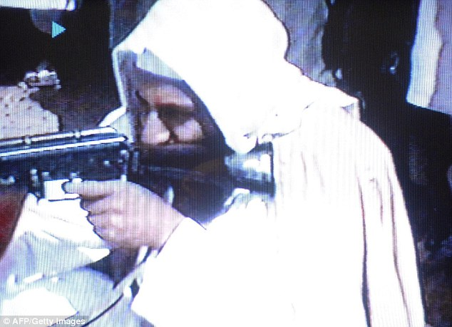 Militants: Osama Bin Laden was pictured with the weapon including in this photo in June 2001