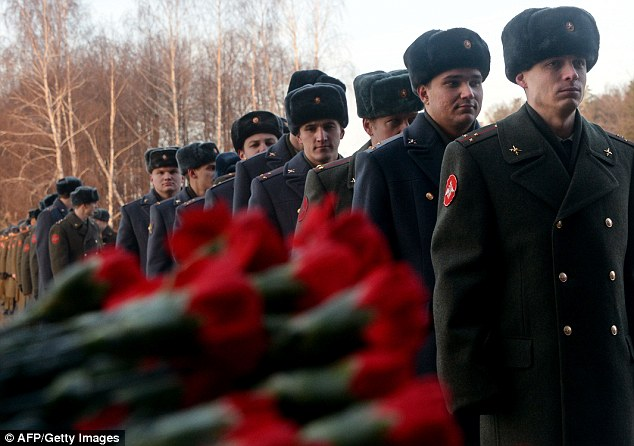 National hero: Russian soldiers stand in line to pay their last respect to Mikhail Kalashnikov, the designer of the iconic AK-47 assault rifle that was the favoured weapon of guerrillas worldwide