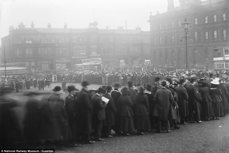 A queue of people waiting to see an ambulance train which was on display at Huddersfield Station in November 1917. The train was one of those later shipped to France to bring casualties from Flanders to the French ports
