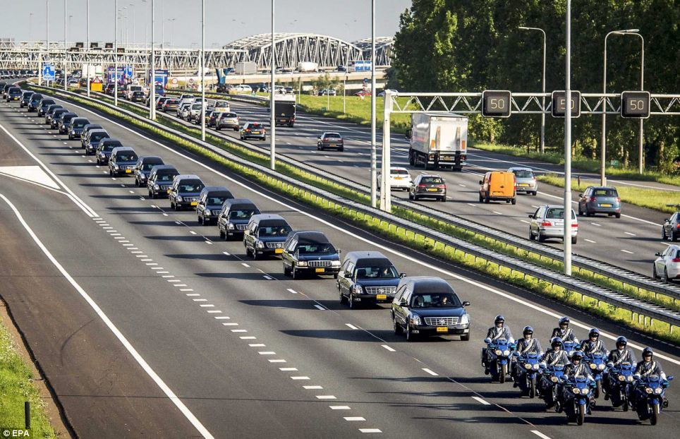 Final journey: A convoy of hearses today carried a second batch of Mh27 victims to a military barracks in Holland following the coffins