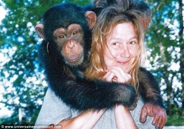 Travis (pictured above with her) ripped off her nose, lips, eyelids, part of her jaw and hands when she was mauled in 2009