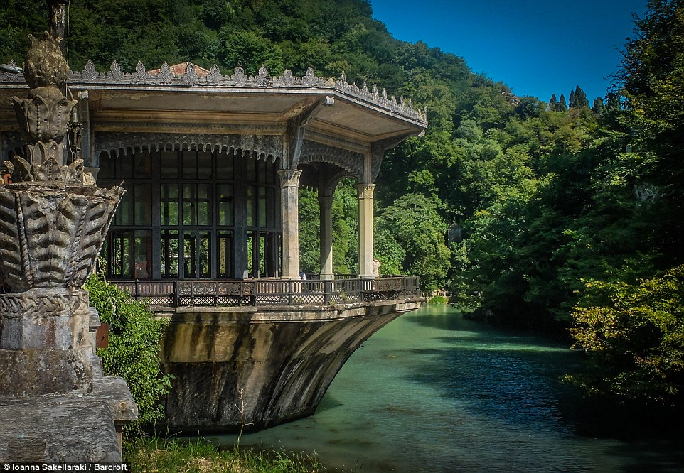 This beautiful photograph shows the contrast between the lake and the  abandoned train station in, New Afon, Abkhazia