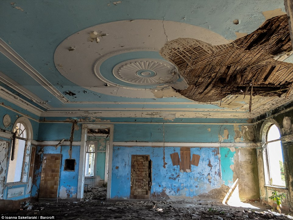 Plaster has been ripped off the ceiling of one of the main rooms in the  abandoned  Ochamchire train station
