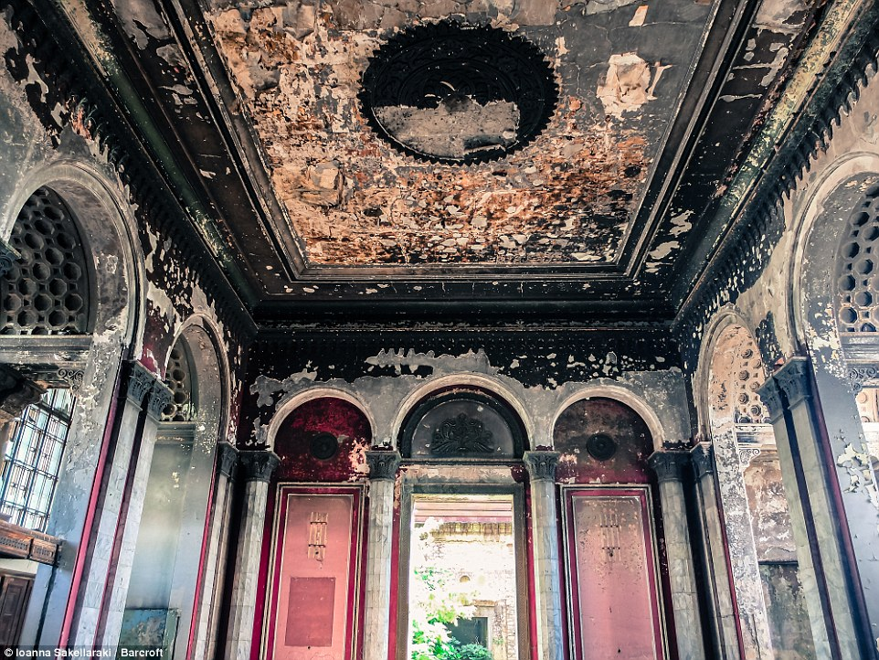 Peeling paint and faded murals can be seen in the interior of this abandoned former Soviet train station in Sukhumi, Abkhazia