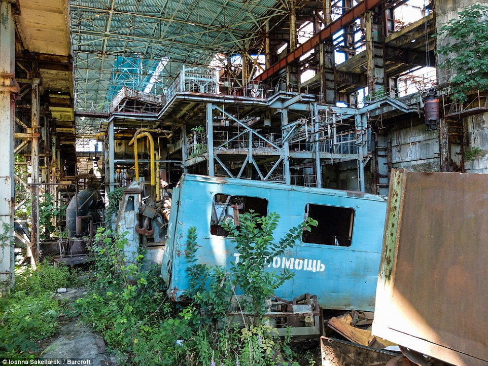 Weeds and plants have started to take-over the former Soviet factory in Tkvarcheli, Abkhazia (shown)