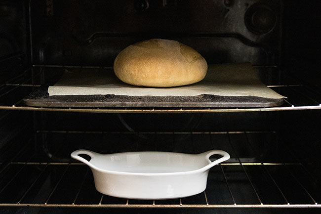 crusty bread on a baking steel in the oven