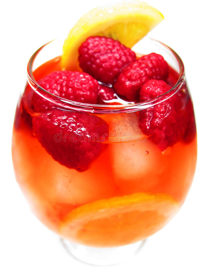 Fruit red punch cocktail drink with raspberry royalty free stock images