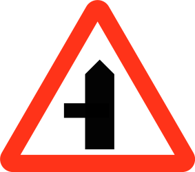 Traffic sign of Bangladesh: Warning for a crossroad with a side road on the left