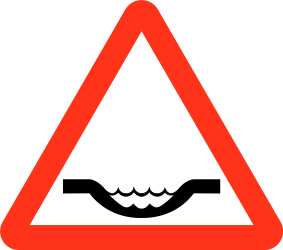 Traffic sign of Bangladesh: Warning for a dip in the road
