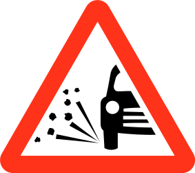 Traffic sign of Bangladesh: Warning for loose chippings on the road surface